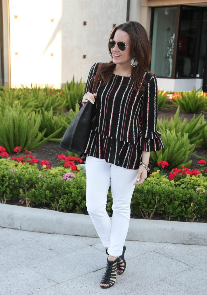 Houston fashion blogger wears weekend outfit idea including peplum top with white jeans and black wedges.