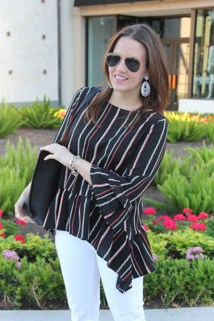 Houston style blogger wears bell sleeve peplum top and shares spring trends.