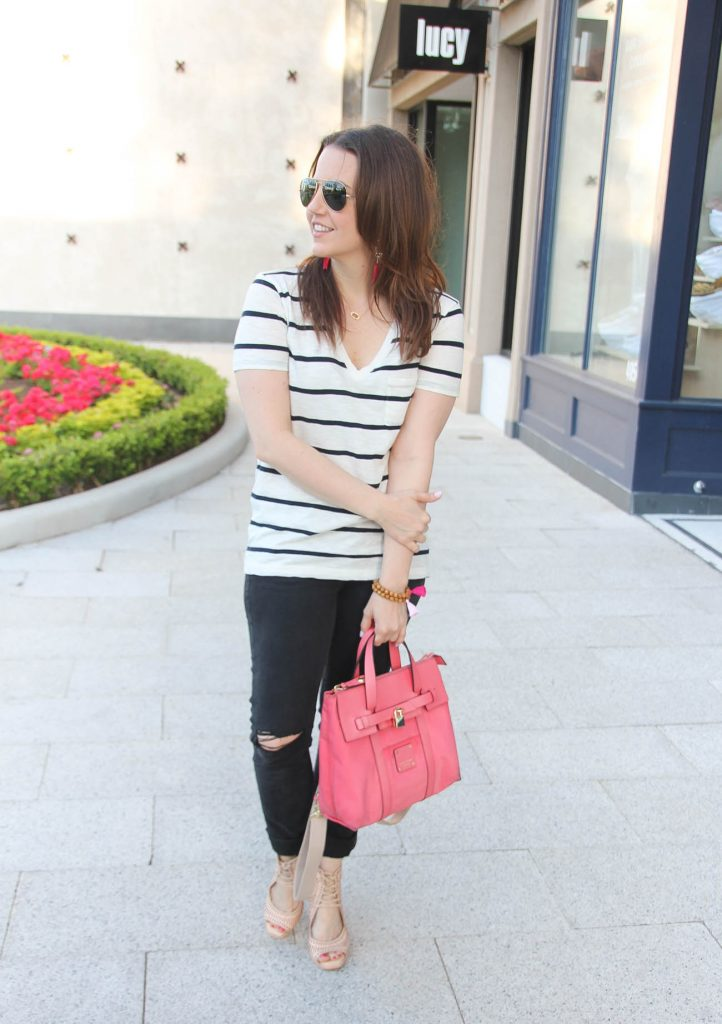 Houston Fashion Blogger wears casual outfit idea striped vneck tee paired with distressed jeans and nude wedge sandals.