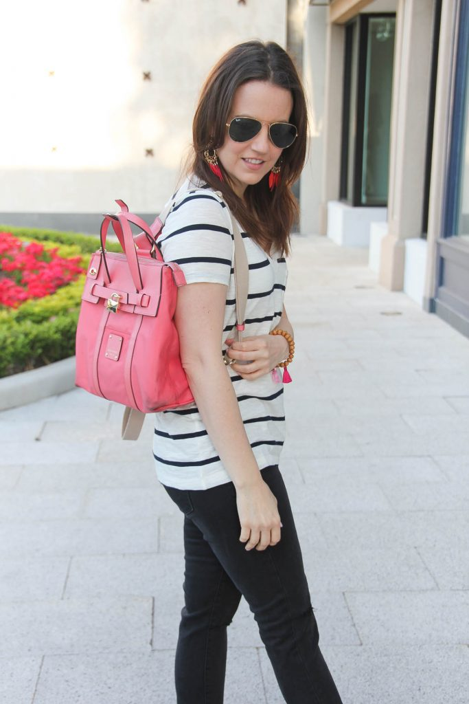 Houston Fashion Blogger carries Henri Bendel mini jetsetter bag in pink.