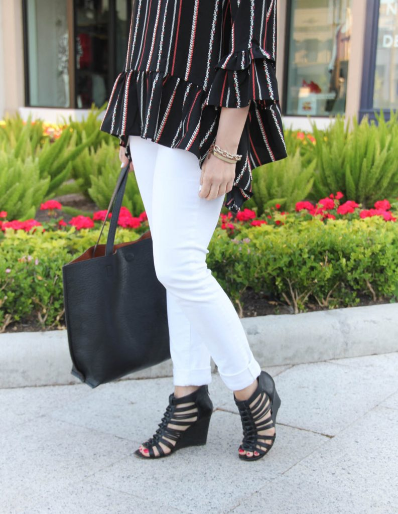 spring outfit inspiration including white skinny jeans, black caged wedges, and peplum top with bell sleeves.