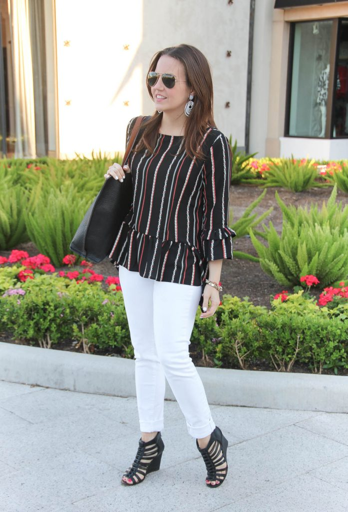 Houston fashion blogger wears weekend outfit idea including white jeans, black wedges, and peplum top.