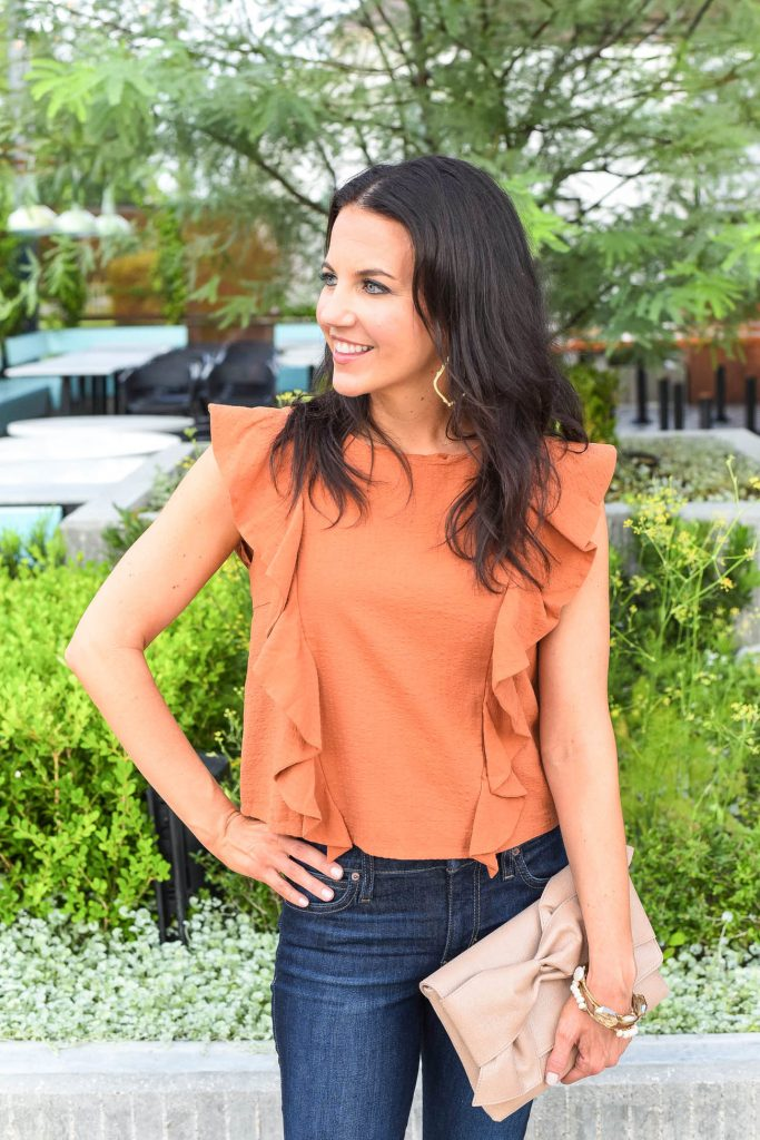casual outfit | orange sleeveless top | neutral clutch | Houston Fashion Blogger Lady in Violet