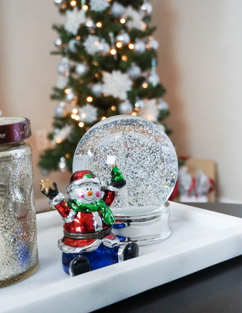 apartment christmas decorations | holiday snow globe | coffee table decor | Houston Lifestyle Blogger Lady in Violet