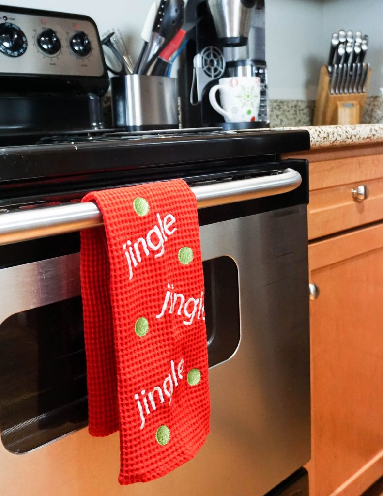 apartment kitchen | Christmas decorations holiday towels | decorating a small space for Christmas | Houston Blogger Lady in Violet