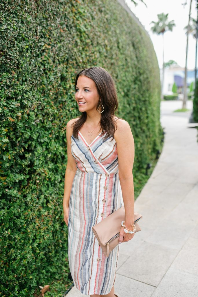 summer wedding outfit | multi colored striped dress | neutral clutch | Houston Fashion Blogger Lady in Violet