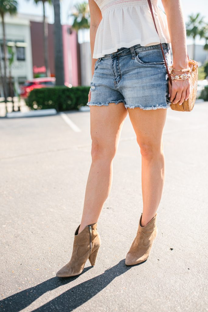 Summer outfit | cut off denim shorts | brown suede booties | Petite Fashion Blogger Lady in Violet