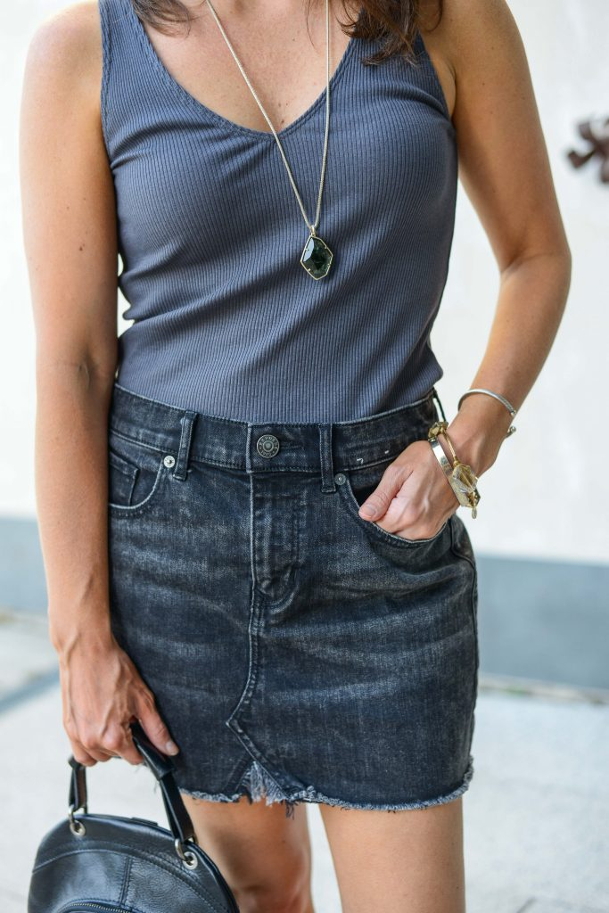 casual outfit | dark gray top | faded denim cutoff skirt | Petite Fashion Blogger Lady in Violet