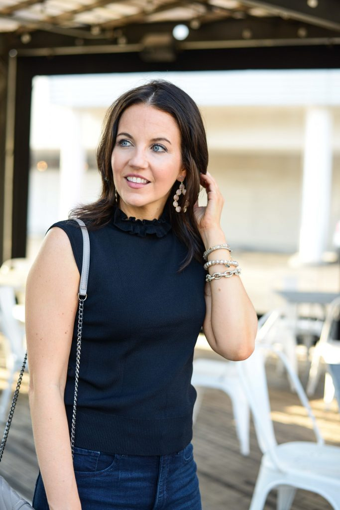 casual outfit | black sleeveless knit turtleneck top | pink stone statement earrings | Popular Fashion Blog Lady in Violet
