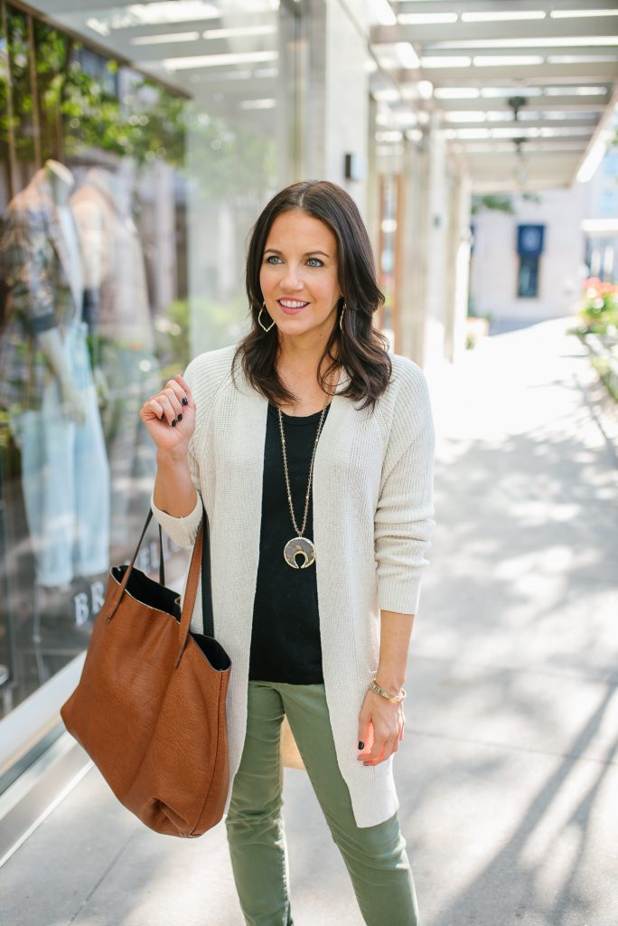 layered fall outfit | beige cardigan | black tee | Houston Fashion Blogger lady in violet