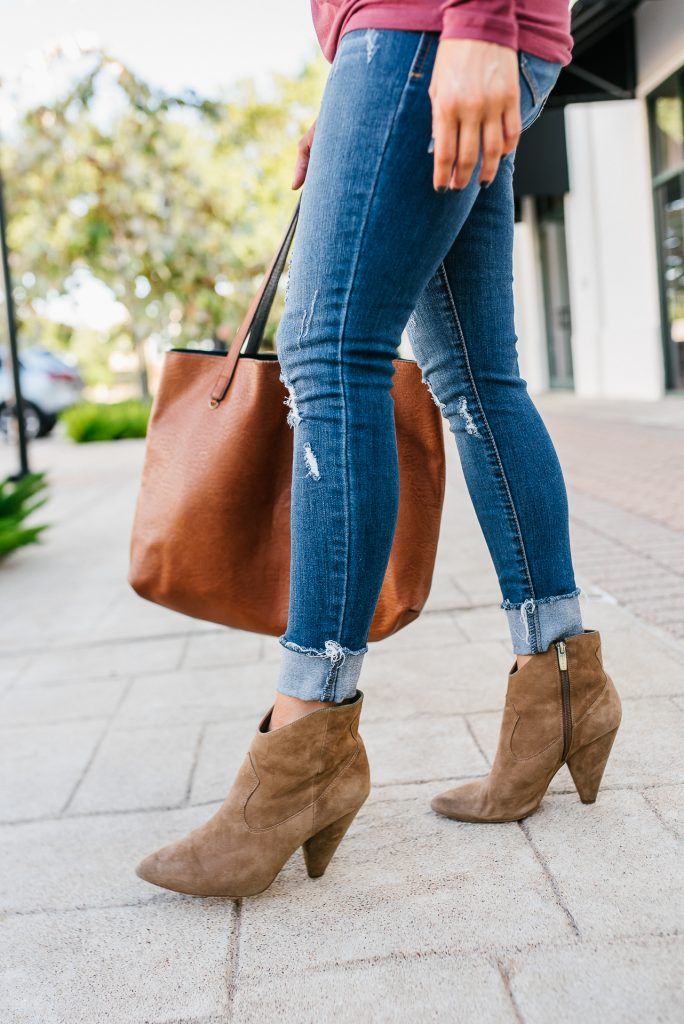 casual outfit | brown western booties | distressed cuffed jeans | Petite Fashion Blog lady in violet