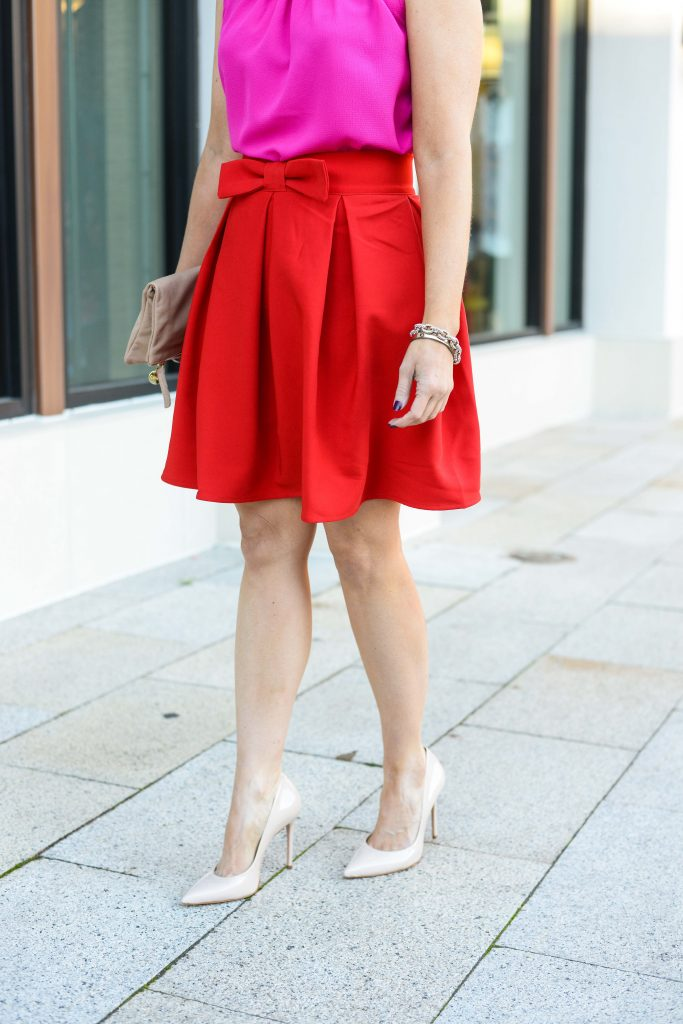 holiday party outfit | red bow mini skirt | nude colored heels | Texas Fashion Blog Lady in Violet