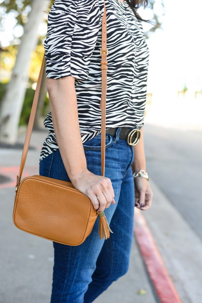 casual outfit | light brown small crossbody handbag | zebra printed tee | Popular Fashion Blog Lady in Violet
