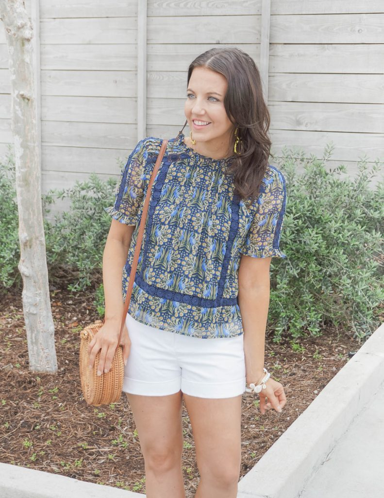 casual spring outfit | yellow blue floral print blouse with a circle straw purse | Houston Fashion Blog Lady in Violet