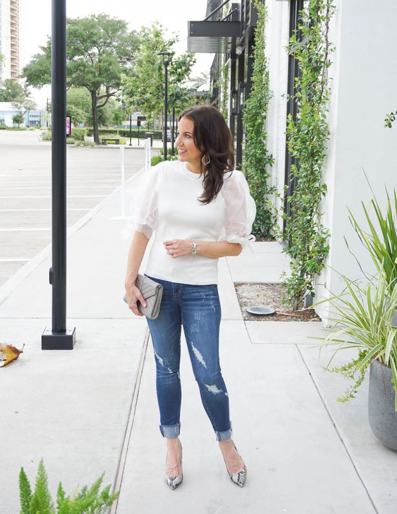 summer outfit | white puff sleeve blouse with distressed denim | Petite Fashion Blog Lady in Violet