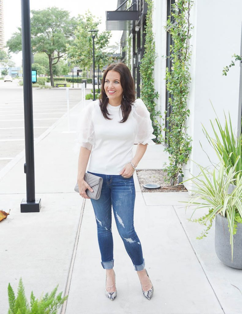 street style | white puff sleeve sweater with distressed denim | Popular Texas Fashion Blog Lady in Violet