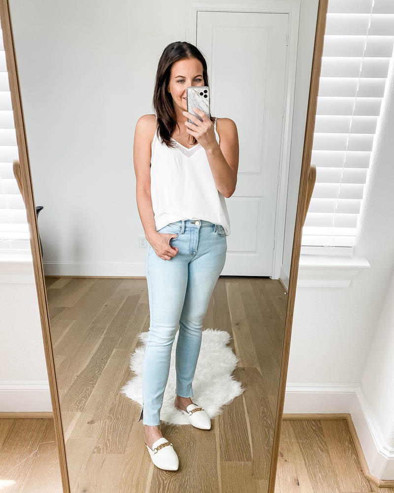 petite fashion | light wash frayed hem jeans | white slides shoes | Casual style blog Lady in Violet