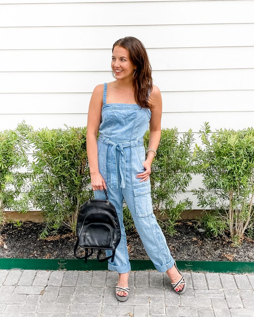 date night outfit | denim jumpsuit | black backpack purse | Petite Fashion Blogger Lady in Violet