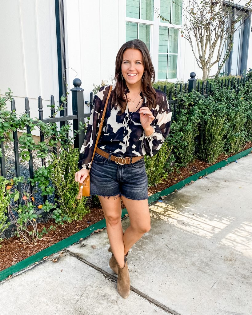 warm fall outfit | cow print top | black cutoff jean shorts | houston fashion blogger lady in violet