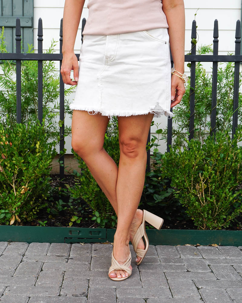 spring outfit | white cutoff jean skirt | light colored slide sandals | Petite Fashion Blog Lady in Violet
